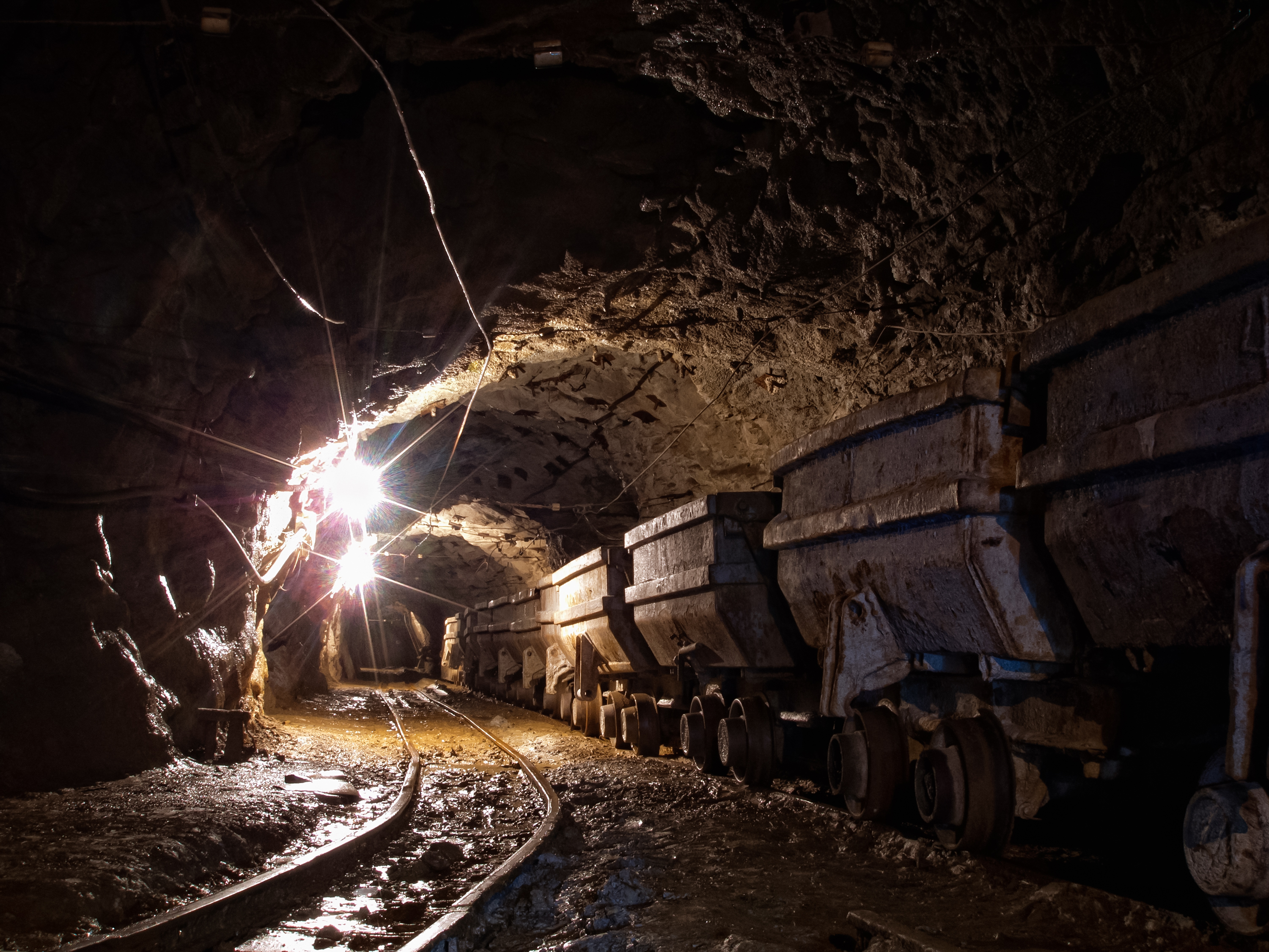 multiple wagons in gold mine